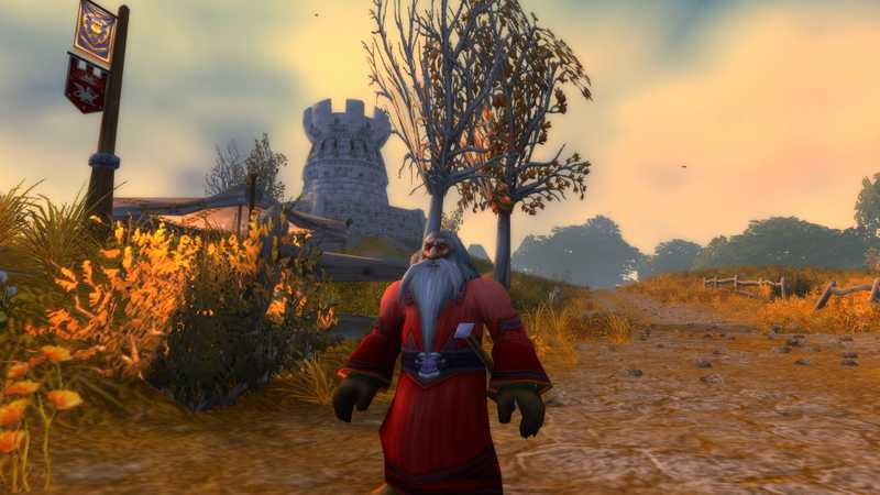 A Dwarf Priest in Westfall looking awesome with a tower in the background.